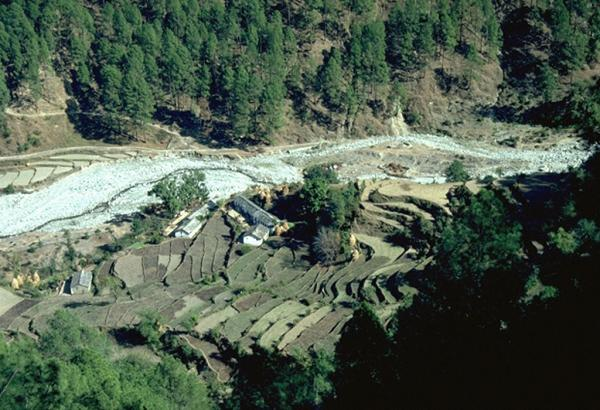 Photo of houses and terraced fields above the Goriganga River near Munsyari