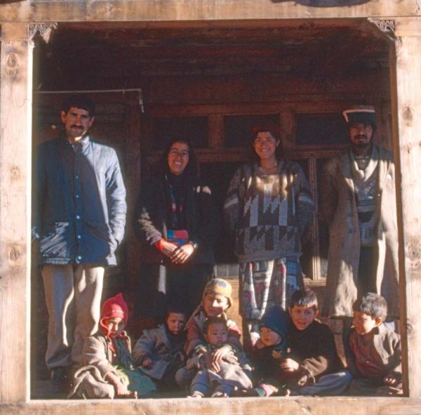 Photo of a family outside their home in the Rupin Valley