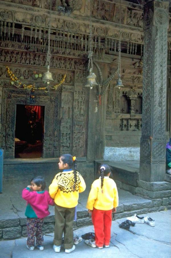 Photo of children outside a temple near Manali
