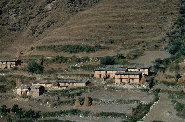Photo of houses in Kumaon, with hay stacked for winter