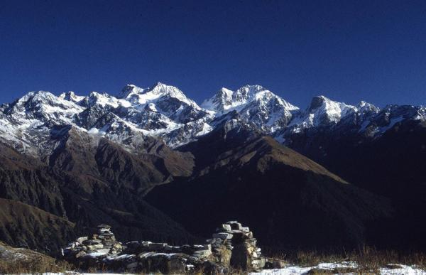 Photo of mountains with ruined cottage in the background