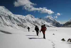 On Pyanchuli Glacier enroute to Chaw Peak.  Syao Kang in background middle right