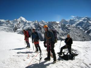 John, Paul, Geoffroy and Marty roping up for the glacier on Eastern aspect of Sy