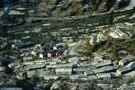 Photo of houses and terraced fields dusted with snow, Wan village, Kumaon